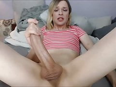 Blonde tranny strokes her monster cock